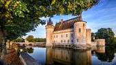 Castle Or Chateau De Sully-sur-loire At Sunset, France. This Old Castle Is A Famous Landmark In Fran poster