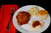 picture of biscuits gravy  - fried chicken mashed potatoes with brown gravy roll and coleslaw - JPG