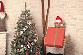 Gift Giving And Exchange Concept. Man Santa Smile And Give Box At Christmas Tree. Holidays Preparati poster