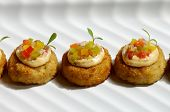 picture of crab-cakes  - Image of miniture crab cakes with garnish - JPG