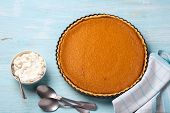Homemade Pumpkin Pie With Cream On A Blue Background, Top View, Free Space. Tasty Traditional Food.  poster