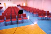 foto of church interior  - A pulpit microphone in an empty room full of chairs - JPG