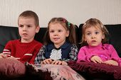 foto of televisor  - three children on sofa 2 watching tv - JPG