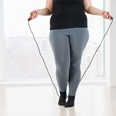 Weight Loss, Endurance, Jump-fit, Vitality, Active Lifestyle. Overweight Woman With Jumping Rope Car poster