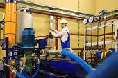 Technician On Power Industrial Plant. Engineer Operate Valve For Industrial Oil Pump System At Stati poster
