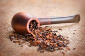 stock photo of tobacco-pipe  - Smoking pipe and tobacco on linen canvas background - JPG