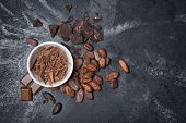 Top View Of Chocolate Chips In White Bowl With Whole Cocoa Beans poster
