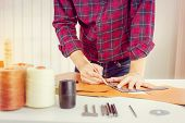 Leather Craftsman With Red Shirt Working Measuring And Writing On Genuine Leather, Handcraft Handmad poster