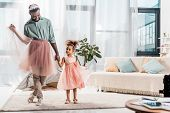 Happy African American Father In Cute Pink Tutu And Adorable Daughter In Beautiful Dress poster