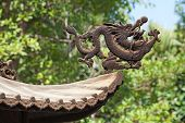 stock photo of lantau island  - Brass dragon on the entrance Po Lin monastery on Lantau Island  - JPG