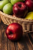 Red Delicious Apple With Fruit Wicker Basket At Background poster