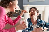 image of chinese food  - Couple Enjoying Chinese Takeaway Meal At Home - JPG