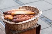 French Baguettes In A Wicker Basket. Outdoor poster