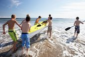 stock photo of teenage boys  - Teenage boys kayaking - JPG
