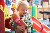 picture of daycare  - Young girl playing with toys - JPG