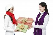foto of filipina  - Two young women exchanging gifts  - JPG