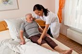 foto of geriatric  - a nurse in elderly care for the elderly in nursing homes - JPG