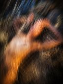 stock photo of nudism  - Motion blur image of naked woman in fishing net - JPG