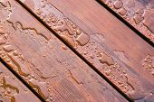 stock photo of woodgrain  - Pooled water on finished deck with woodgrain - JPG