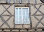 stock photo of poitiers  - Modern white window on a medieval timber - JPG