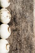 garlic over natural wooden textured table