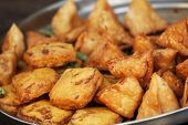 pic of samosa  - Traditional Indian dish samosa on the open market - JPG