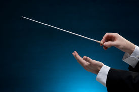 picture of nonverbal  - Male orchestra conductor hands one with baton - JPG