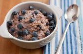 foto of porridge  - healthy oatmeal porridge with blueberries for breakfast - JPG