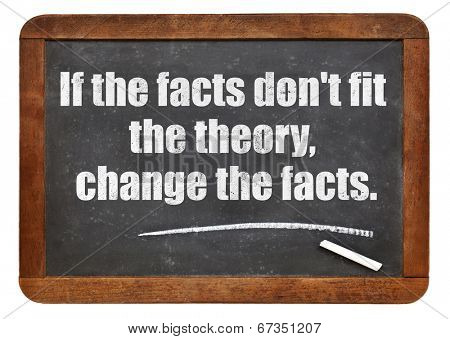 poster of if the facts do not fit the theory, change the facts - a quote from Albert EInstein -  white chalk text  on a vintage slate blackboard