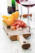 pic of cantaloupe  - Slices of melon cantaloupe with prosciutto ham - JPG