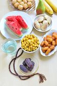 stock photo of prayer beads  - Assorted ramadan special food  - JPG