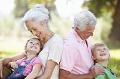 stock photo of grandparent child  - Grandparents with grandchildren in the country - JPG