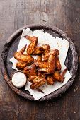 picture of chicken wings  - Fried Chicken Wings with sauce on wooden background - JPG