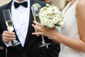 stock photo of champagne glasses  - Bride and groom are holding champagne glasses - JPG