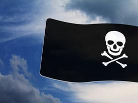 stock photo of skull crossbones flag  - Pirate Black Flag with white Skull and Crossbones sign on blue sky background - JPG