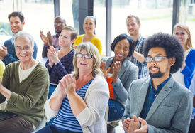 stock photo of applause  - Group of Cheerful People Clapping with Gladness - JPG