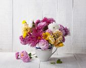 foto of chrysanthemum  - Still life with colourful chrysanthemums bunch on old white wooden board - JPG