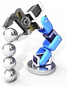 image of ball bearing  - Robot arm building growth in technology business as ball bearings stack - JPG