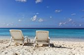 picture of curacao  - Two white deckchairs at tropical beach of Curacao - JPG