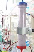 foto of dialysis  - dialysis filter on the background of complex medical equipment - JPG
