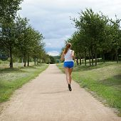 foto of jogger  - female jogger in park seen from behind - JPG