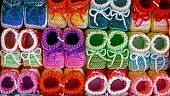 pic of booty  - Knitted booties for newborns from colored wool and exposed to sale - JPG
