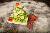 picture of christmas meal  - A Christmas tree salad made with cucumber and cherry tomatoes a healthy kid meal
