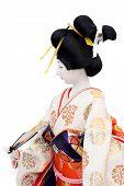 stock photo of geisha  - Side view of traditional Japanese geisha doll - JPG