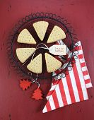 pic of shortbread  - Christmas shortbread triangle cookies on vintage baking rack on dark red rustic wood background with festive decorations - JPG