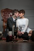 pic of unity candle  - sensual couple sitting on the floor with candles - JPG