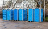 image of septic  - Row of portable toilets on the outdoor - JPG