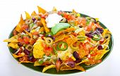 stock photo of nachos  - Nachos on the plate over white background - JPG