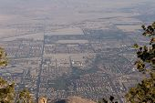 stock photo of smog  - View of The valley from the top of the San Jacinto Mountains in California with a very dense and thick smog layer - JPG