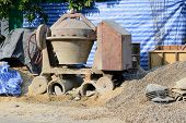 image of construction machine  - Old concrete mixer machine on construction site - JPG